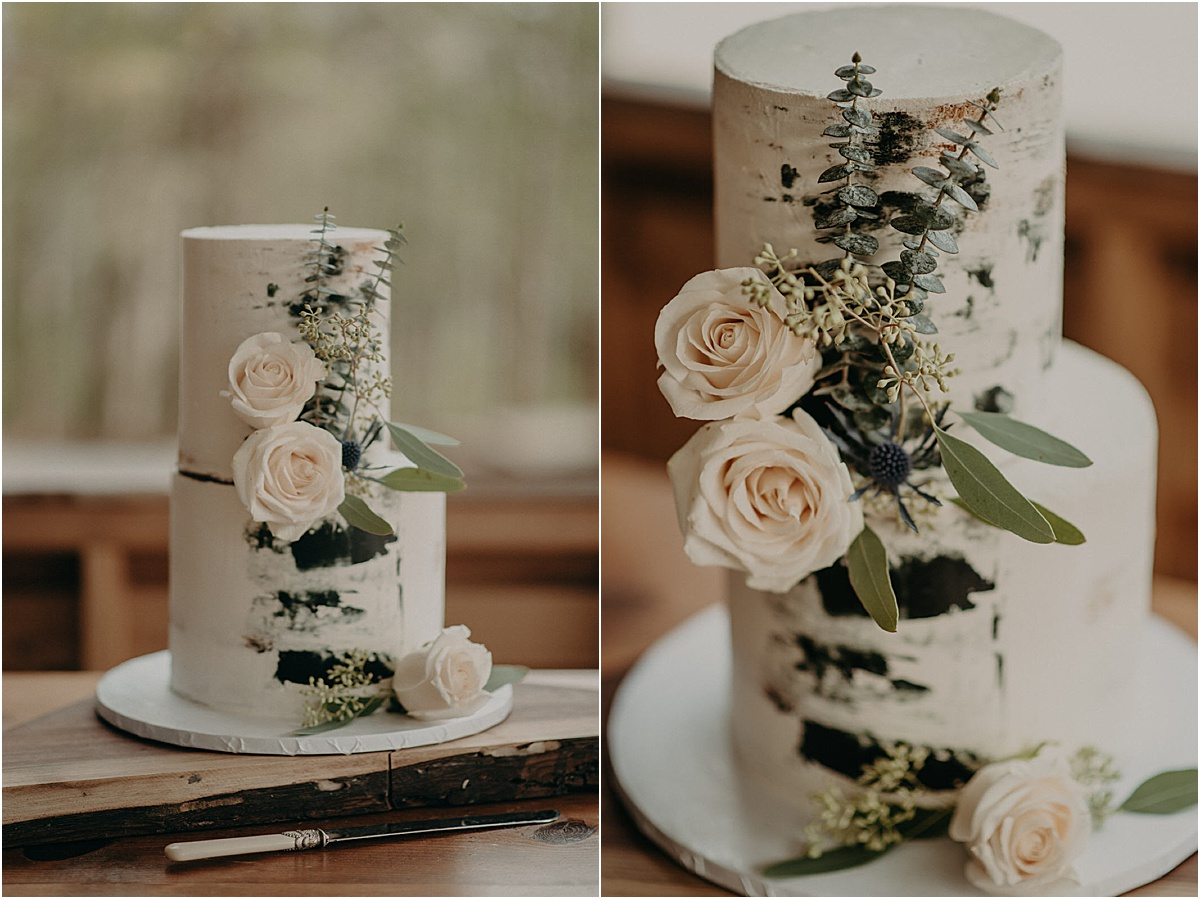 white and green wedding cake with floral details