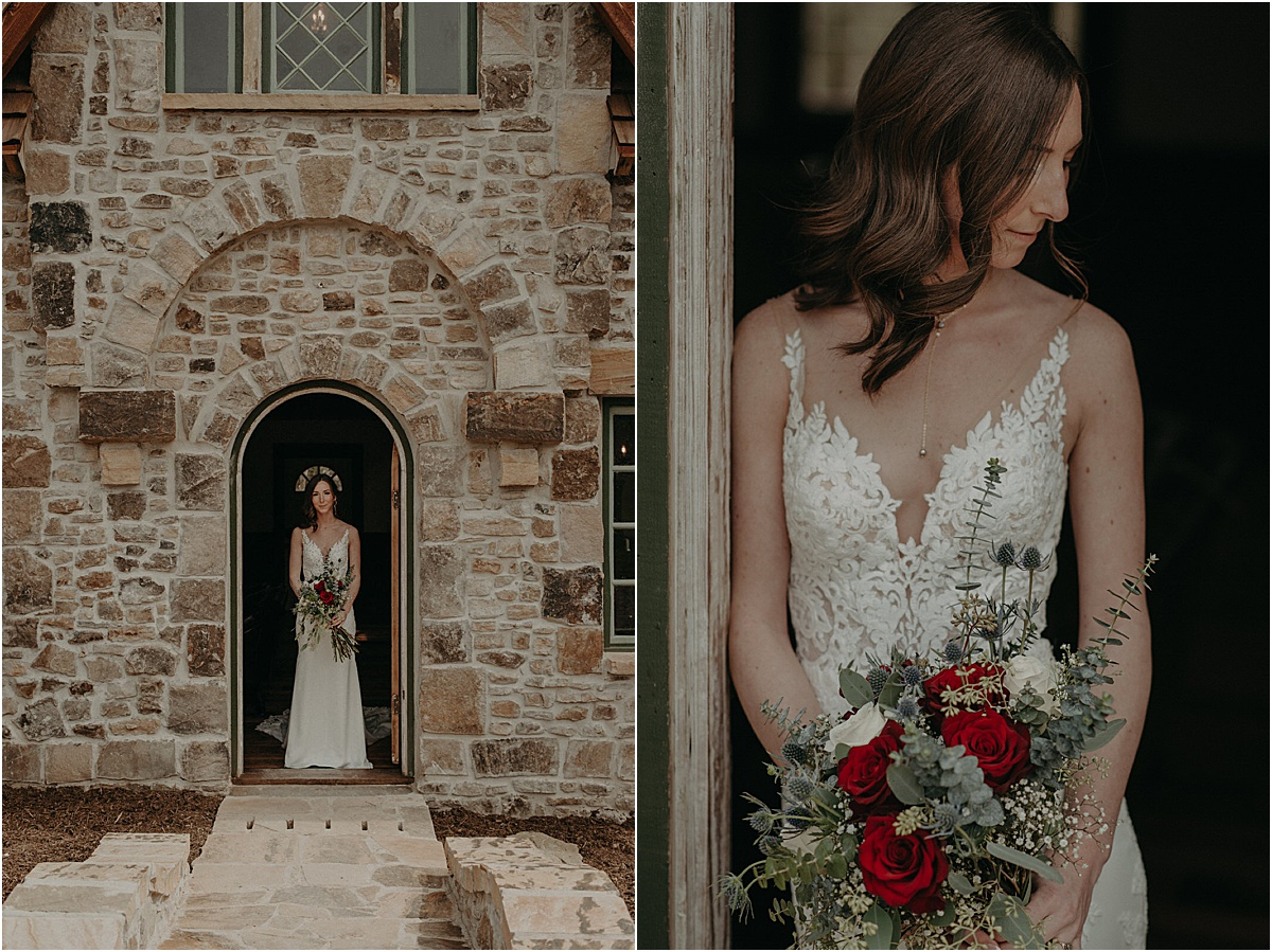 bride with red and green bouquet in front of brick cottage doorway