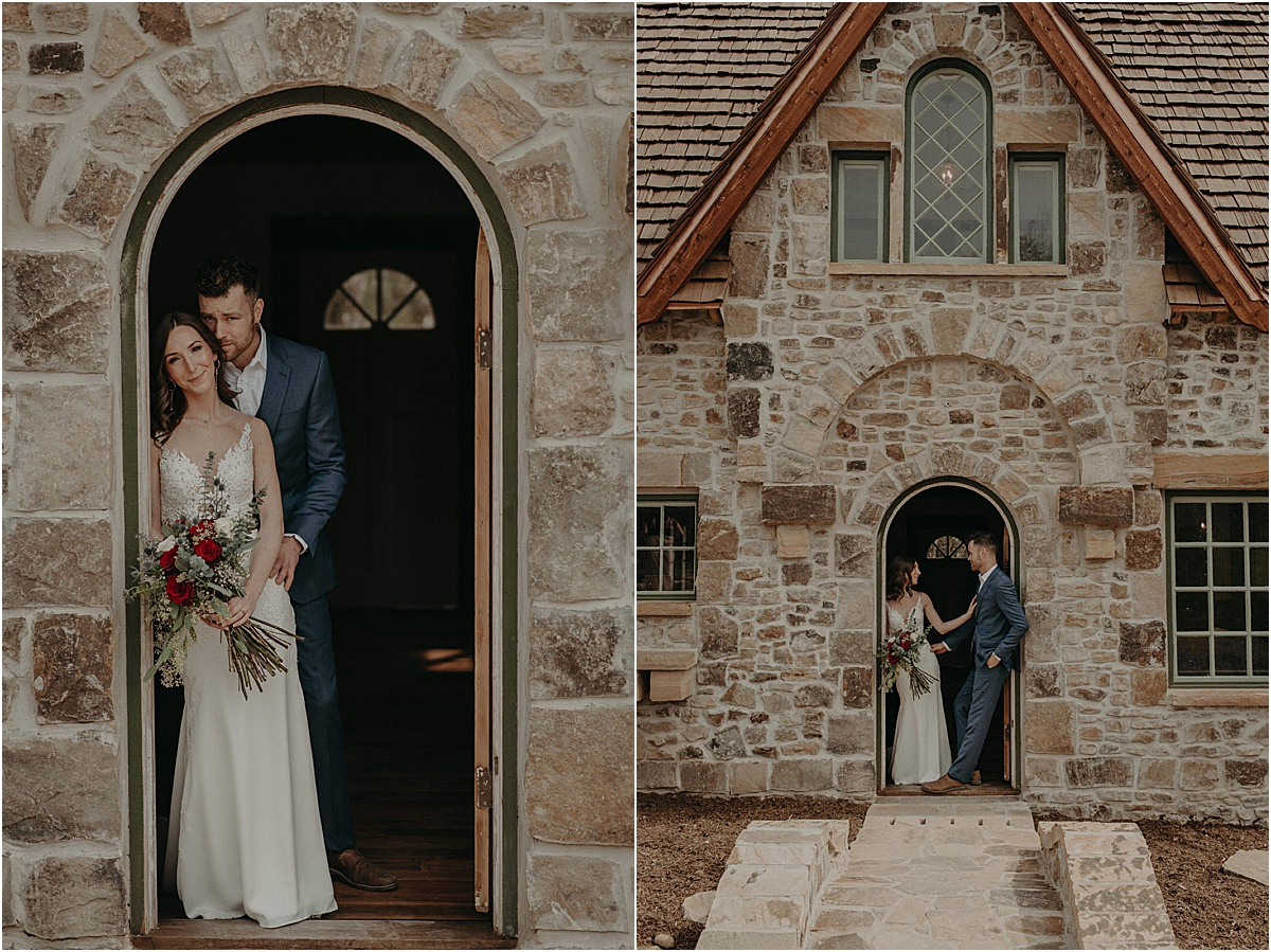 bride and groom standing in doorway of brick cottage