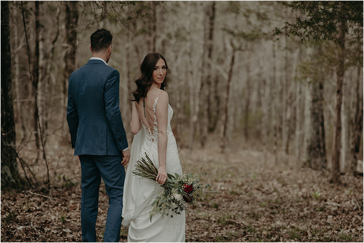 bride and groom walking through forest in georgia