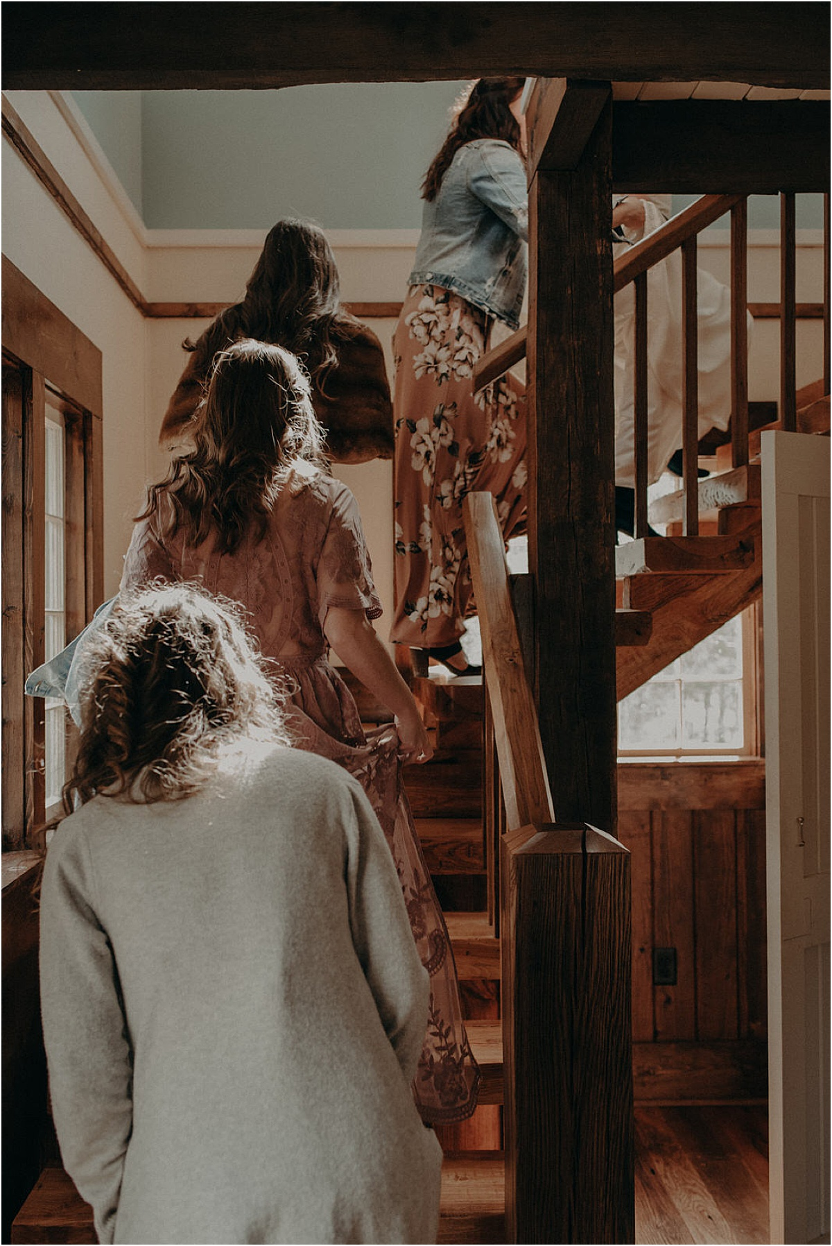 bridal party walking up set of antique stairs