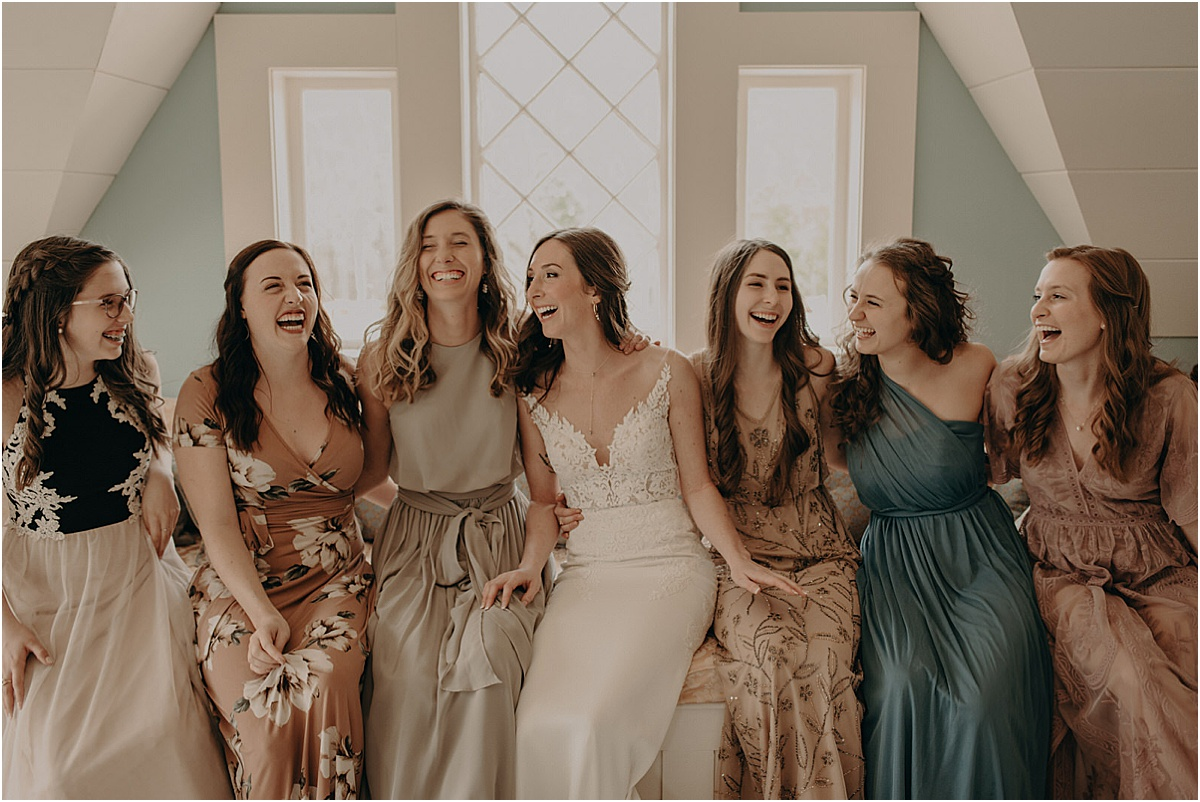bridal party sitting laughing together