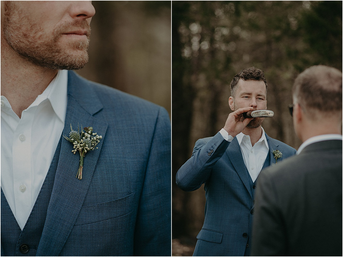 groom in blue suit drinking from a flask