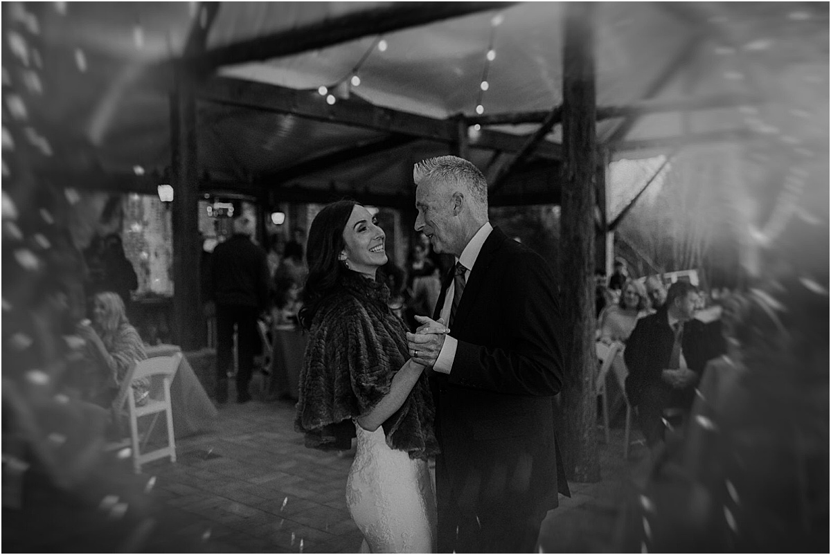 bride dancing with father during reception
