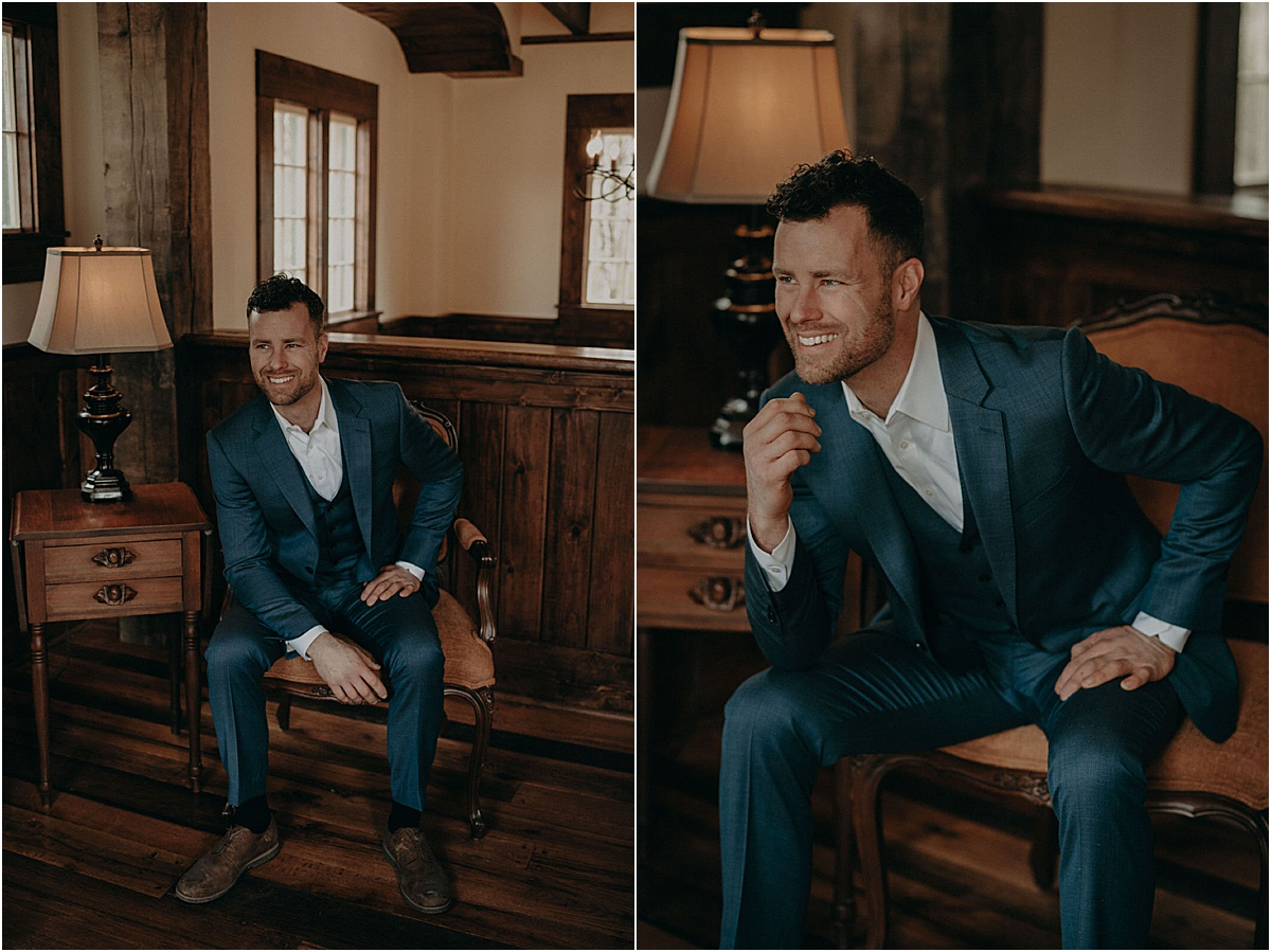 groom in blue suit sitting a rustic room before wedding ceremony