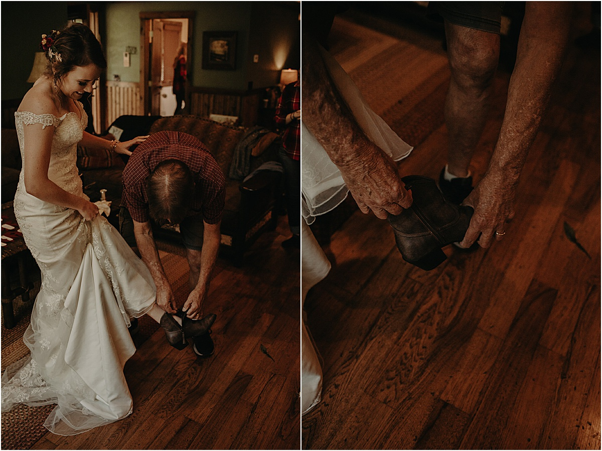 father of the bride helping bride put on boots