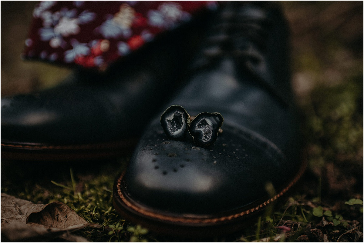 stone cuff links on black dress shoes