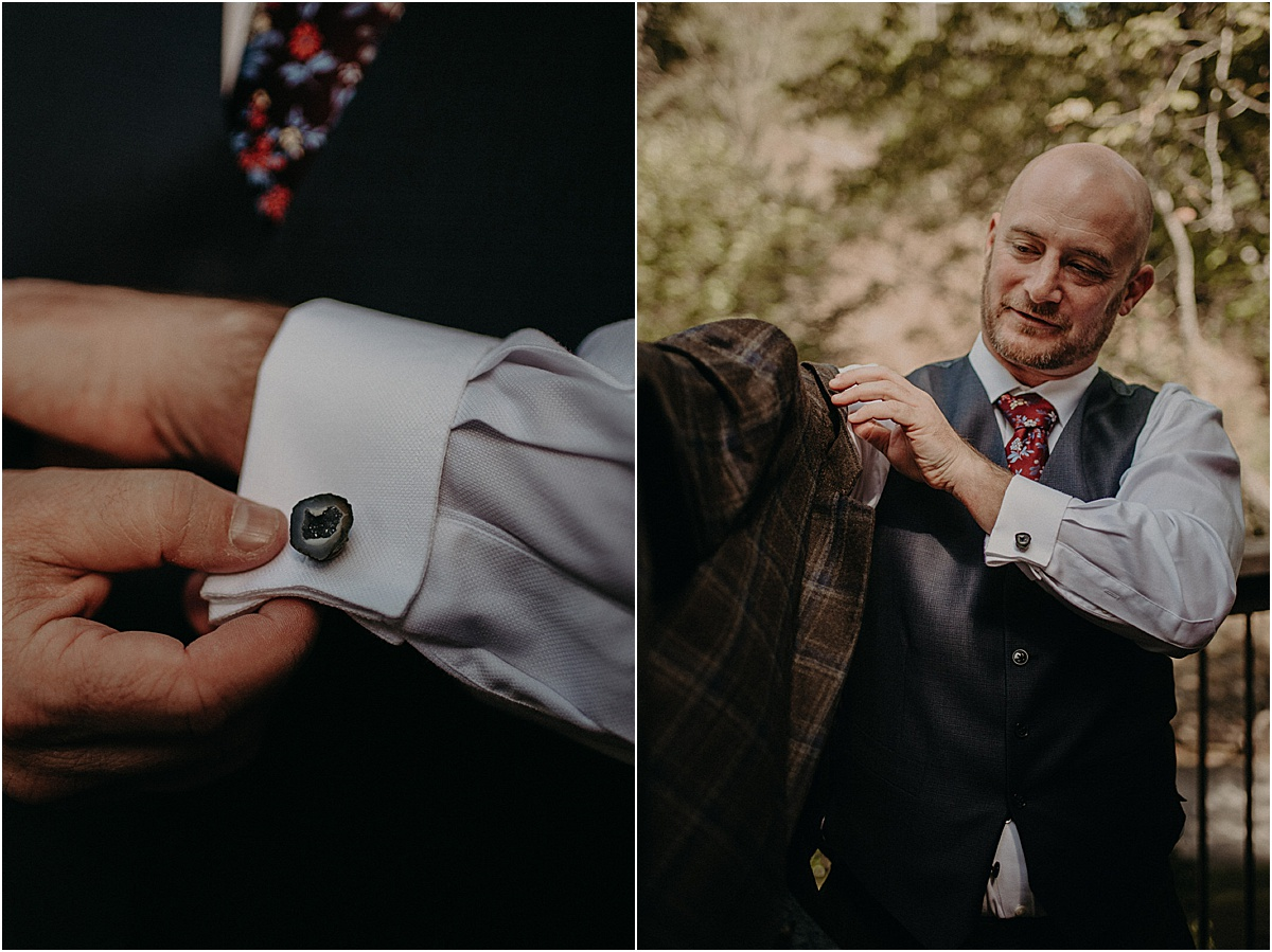 groom putting on cuff links and jacket