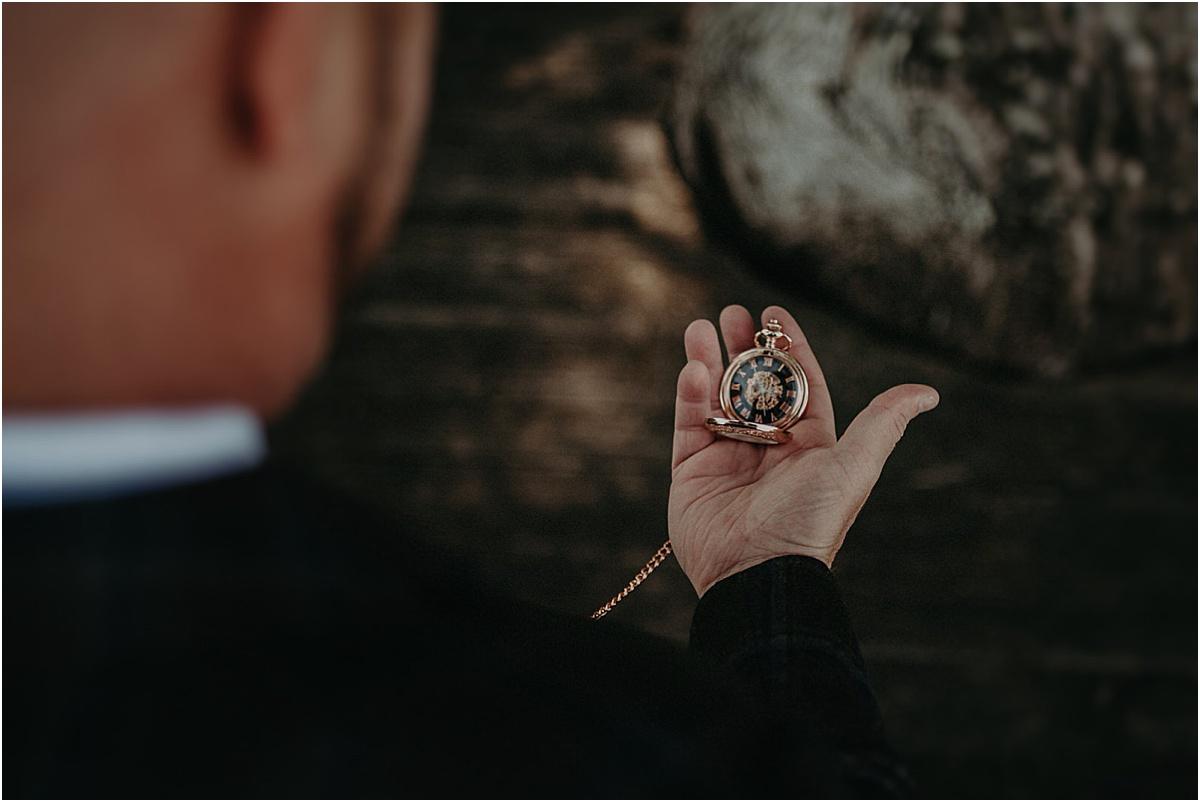 groom checking pocket watch