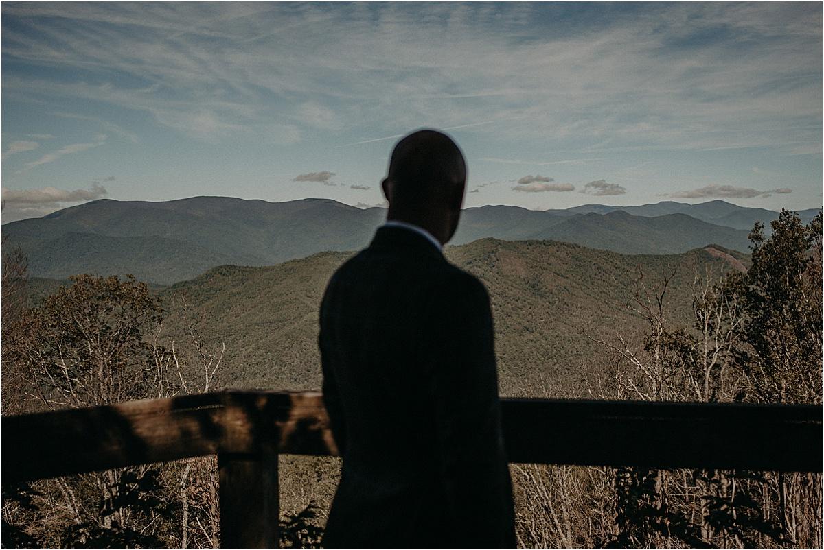 groom overlooking north carolina hills
