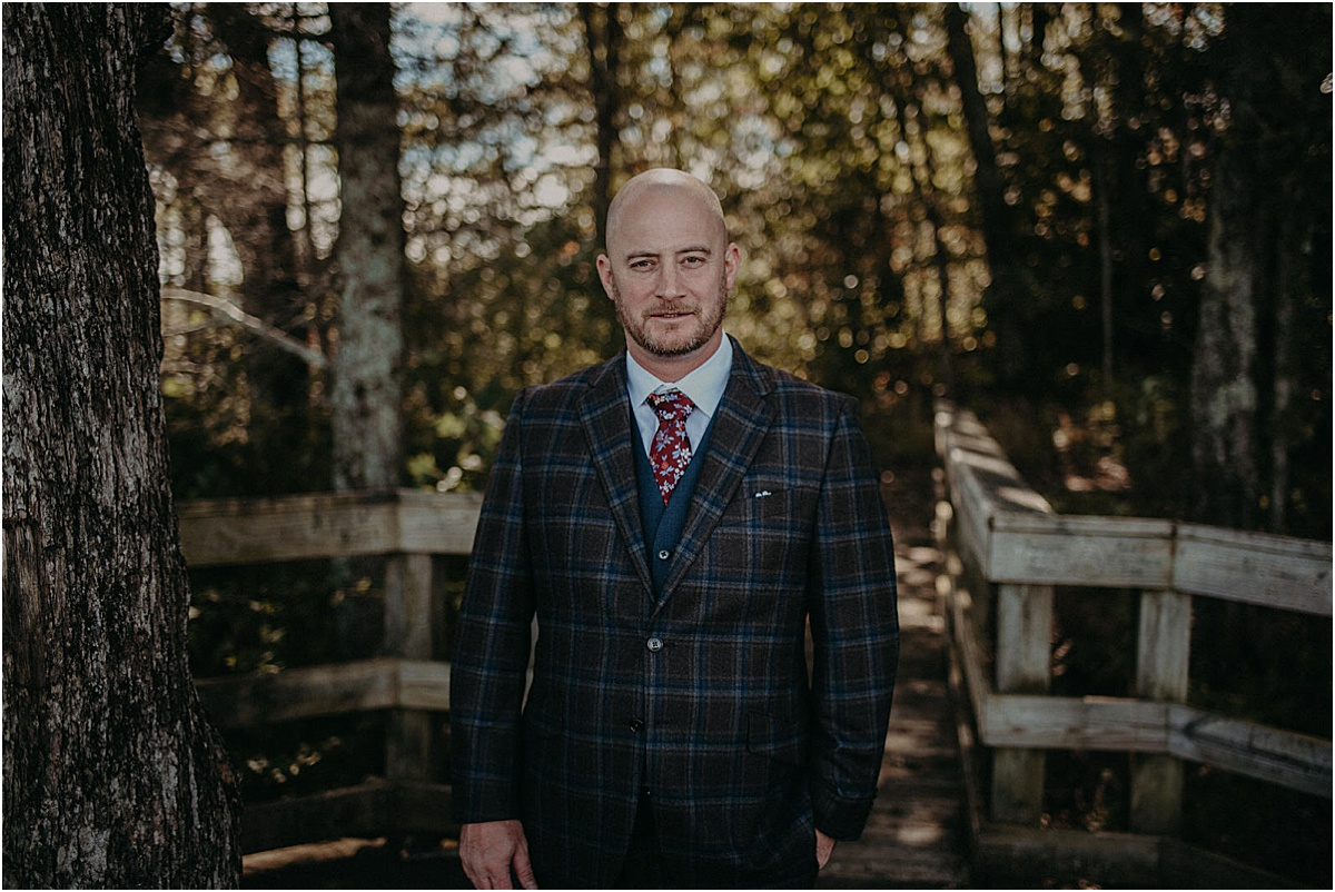 groom in wedding attire waiting for his bride