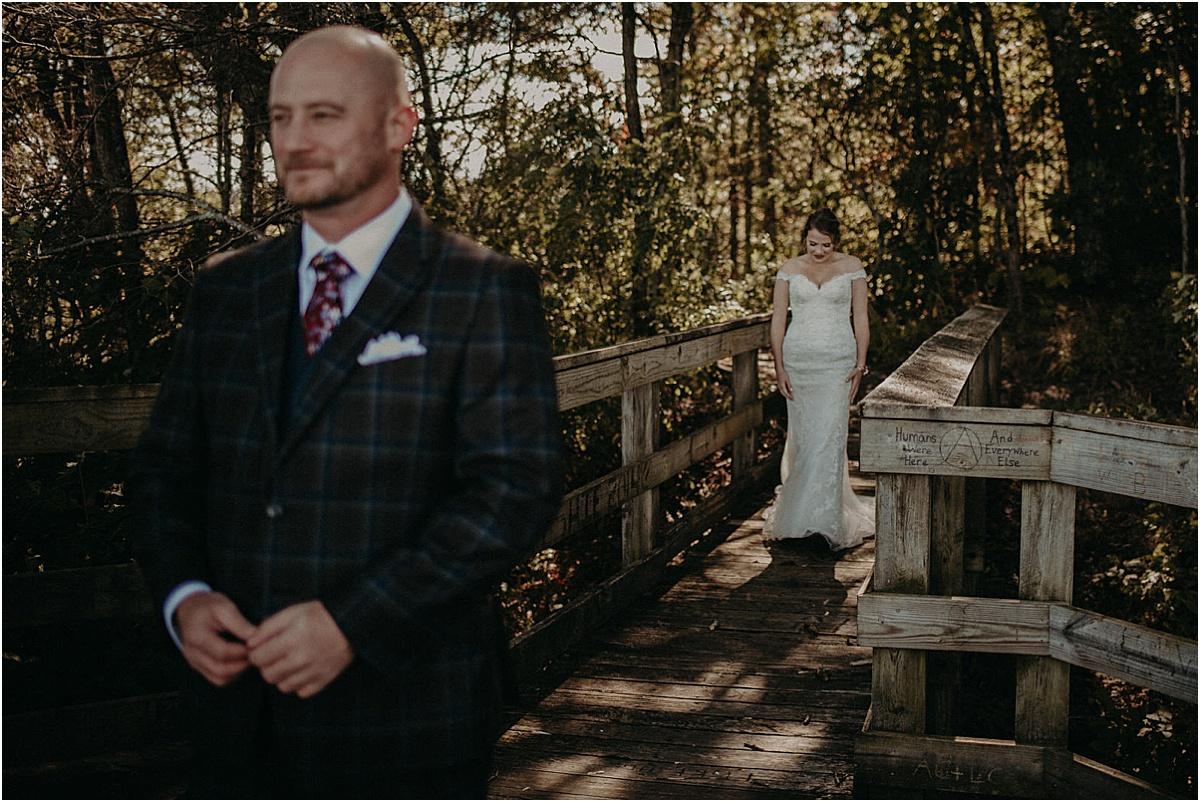 bride walking towards groom for first look