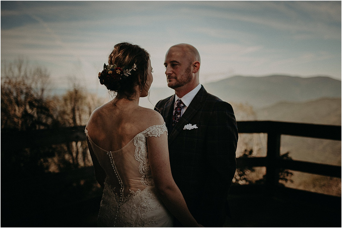 bride and groom facing each other in front of north carolina hills