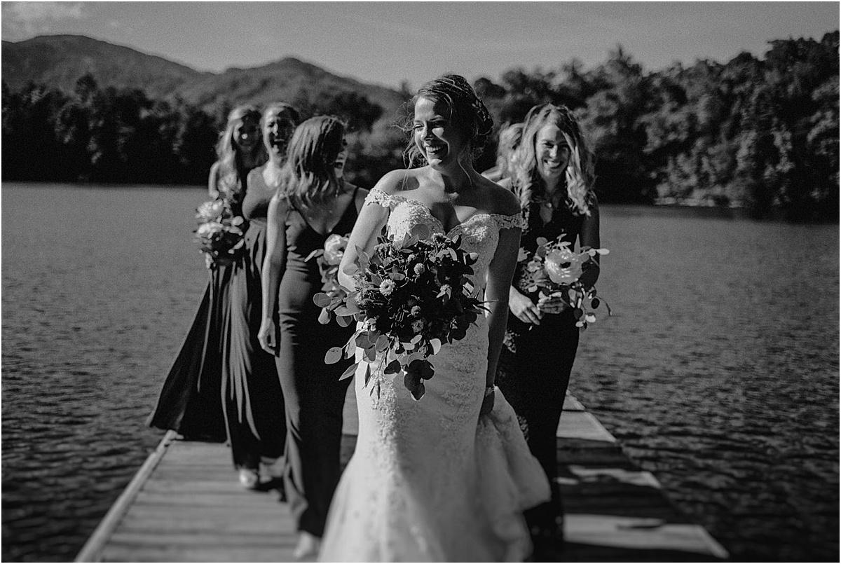bridesmaids posing on lake dock