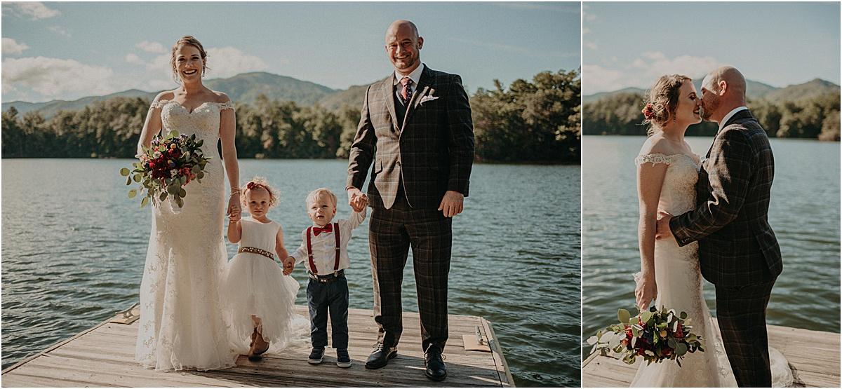 bride and groom on lake dock