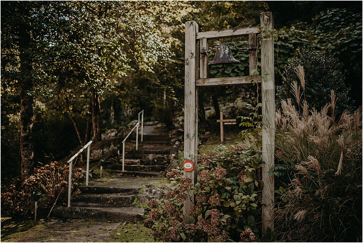 stairs and bell in forest at tapoco lodge north carolina