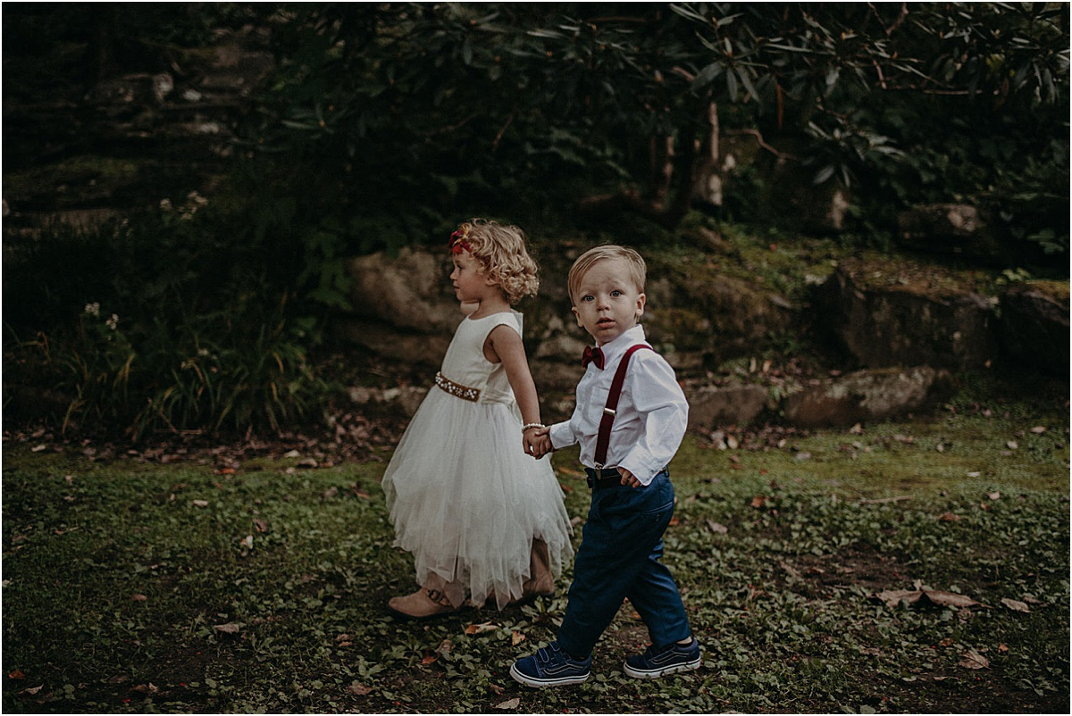 flower girl and ring bearer walking down aisle at wedding