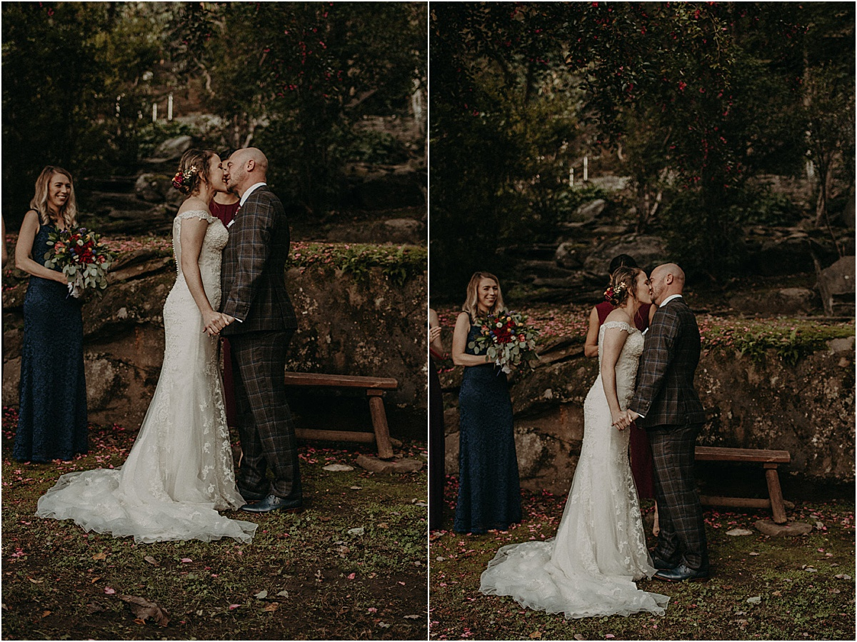 bride and groom's first kiss at the altar