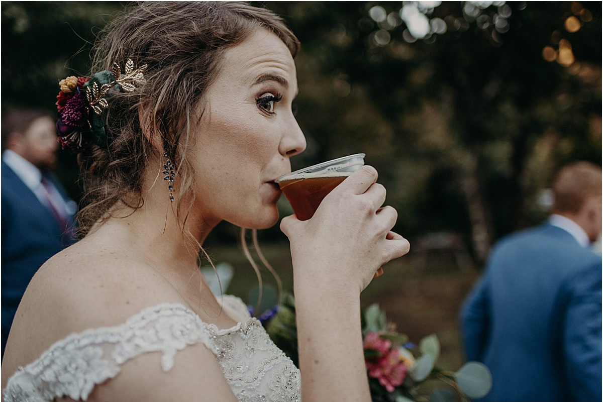 bride drinking beer after wedding ceremony