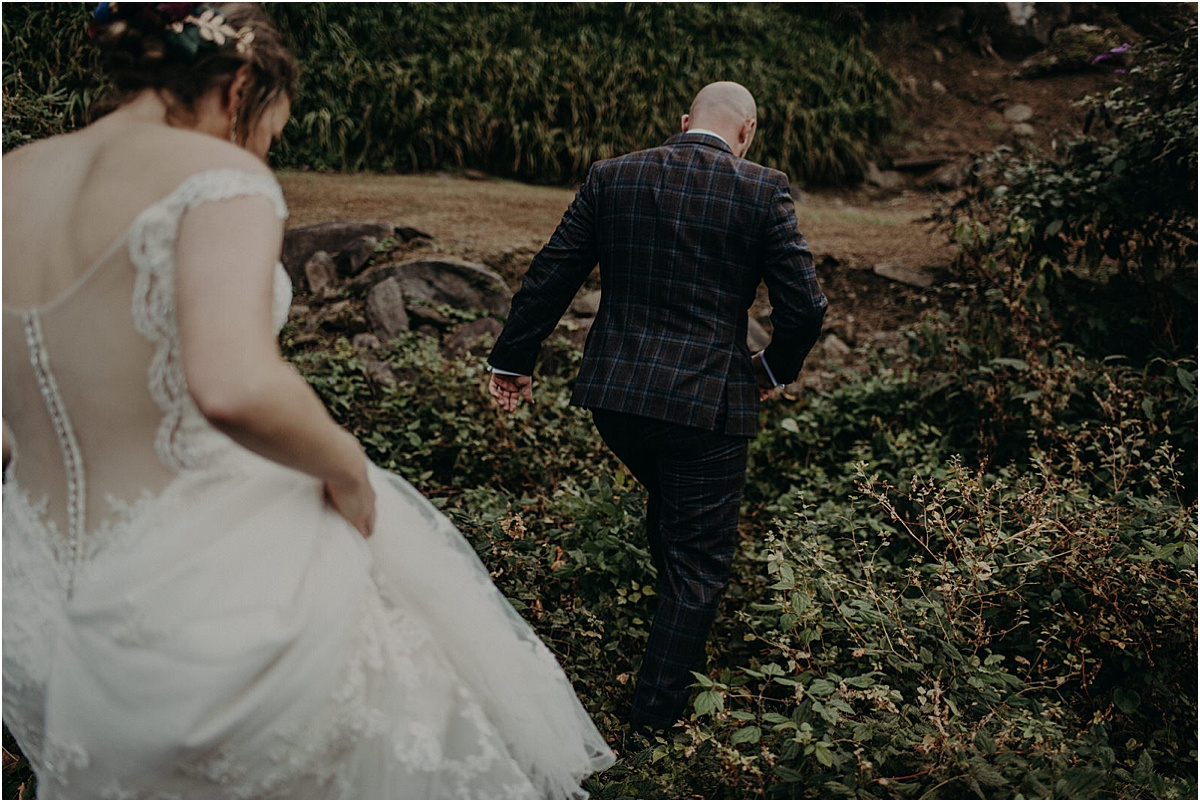 bride and groom walking in north carolina forest