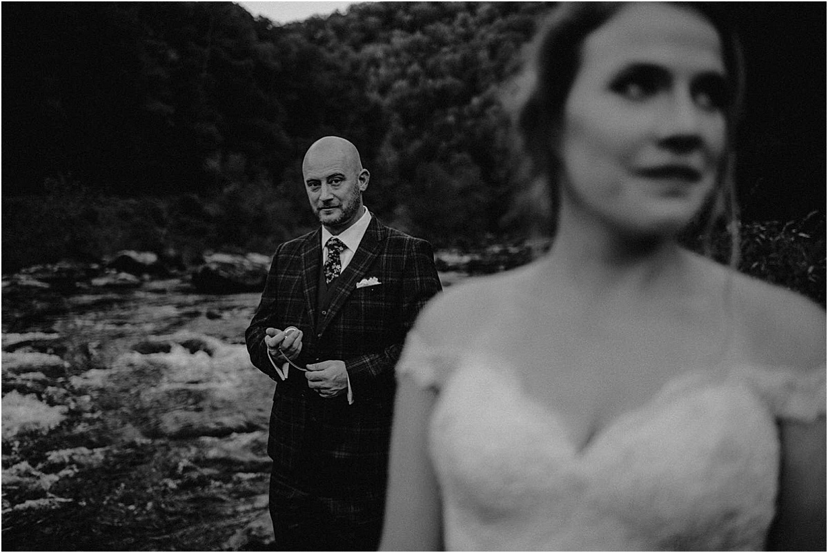 groom looking at pocketwatch