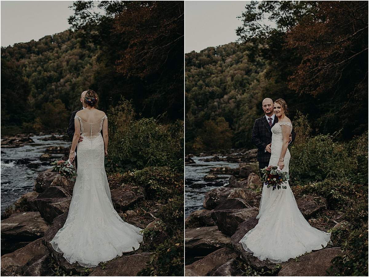 bride and groom embracing in front of river in north carolina