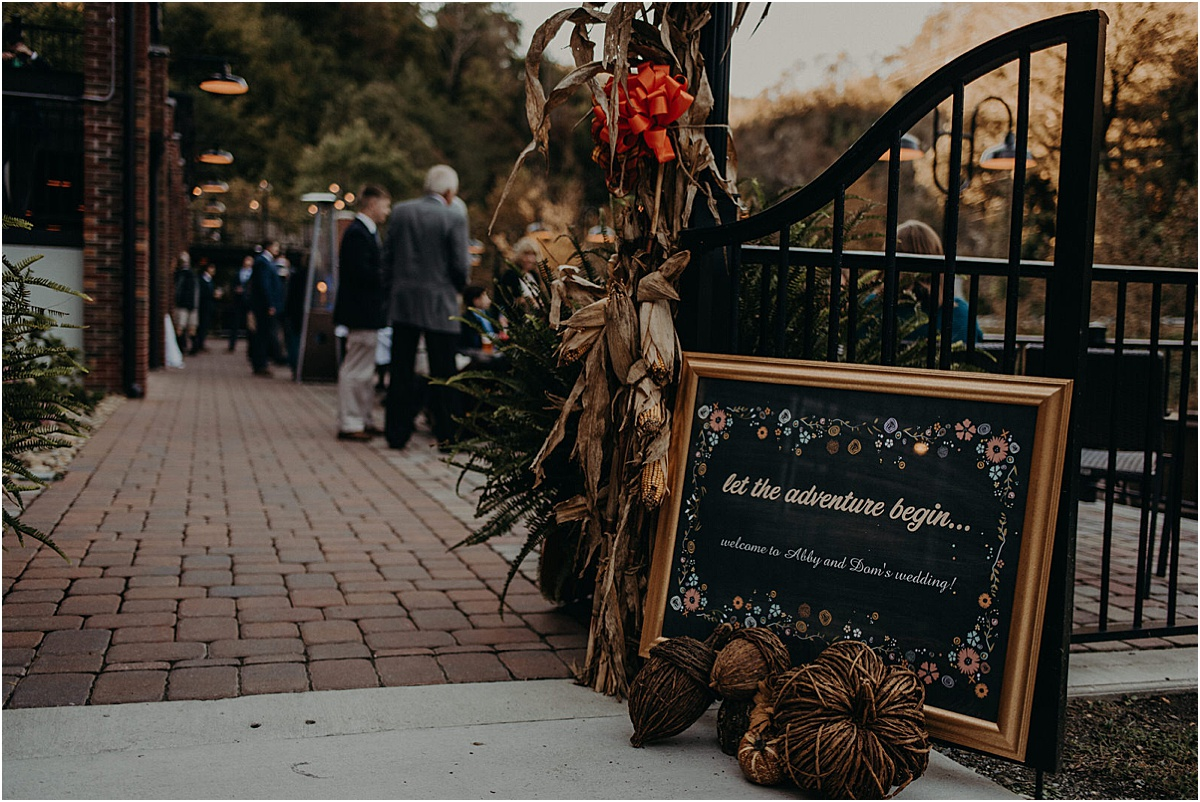 let the adventure begin wedding sign at reception