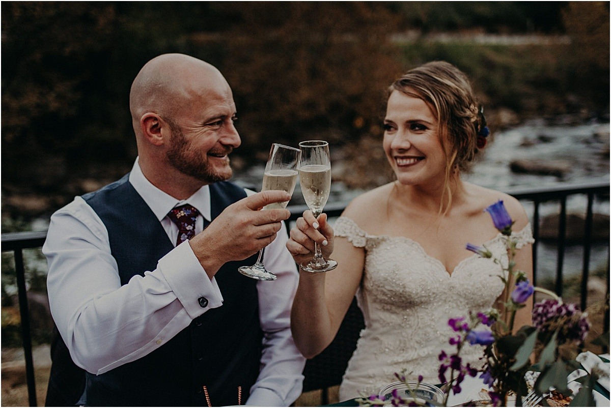 bride and groom making a champagne toast
