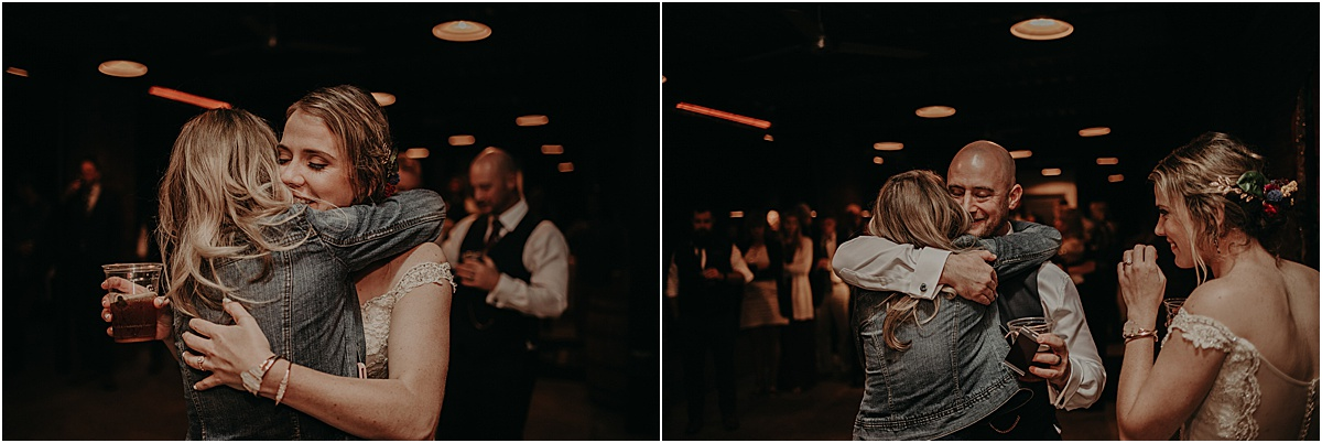 bride and groom hugging guest during toast