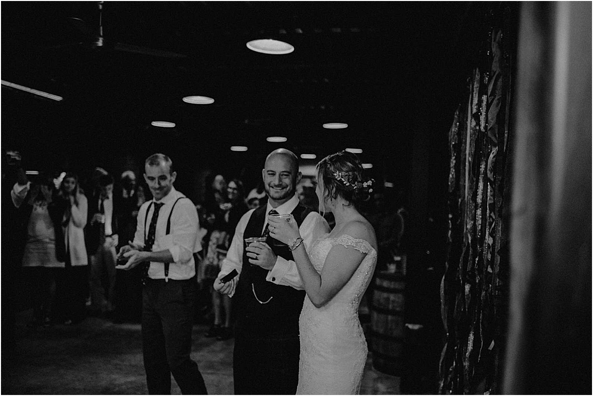 bride and groom smiling during toast
