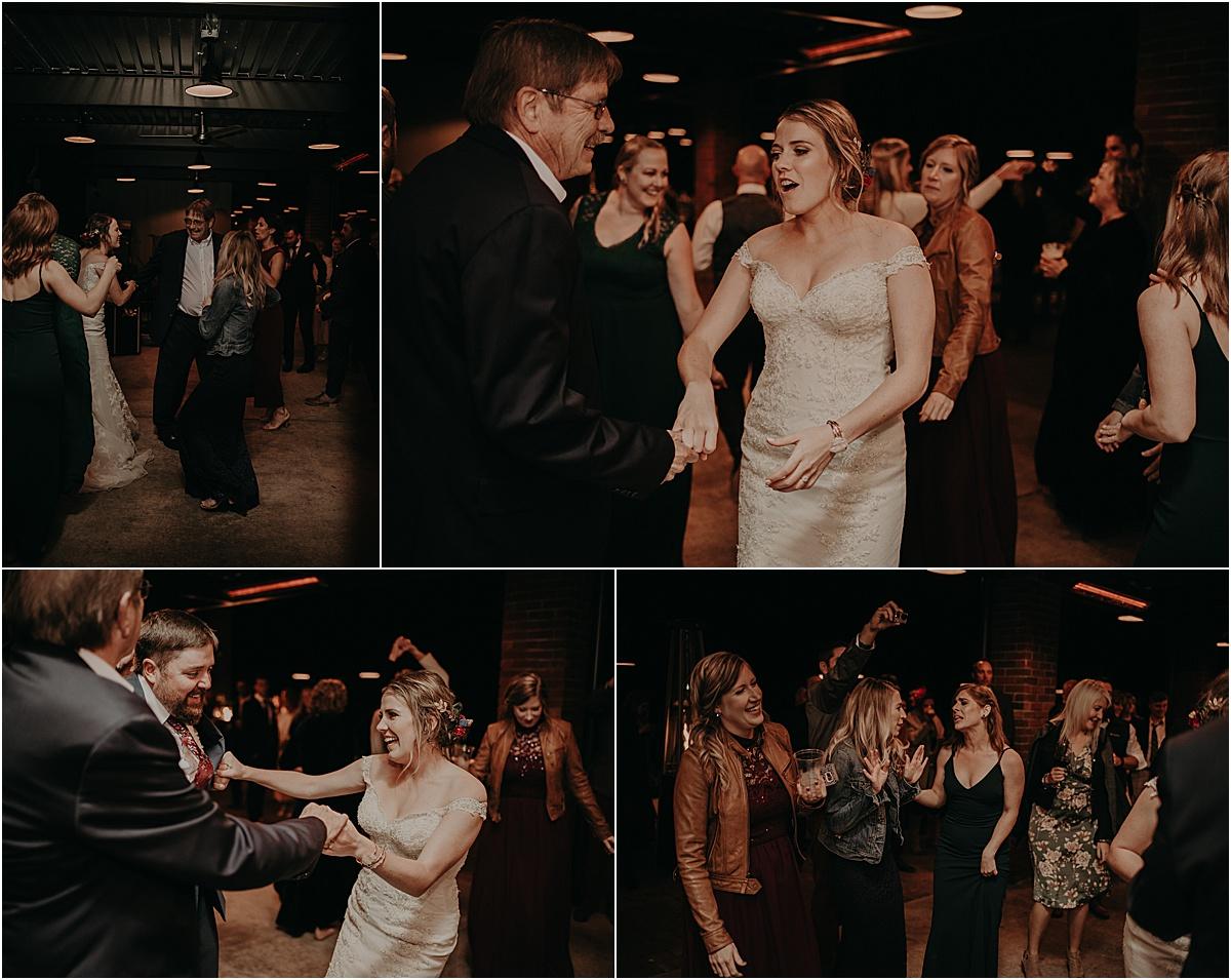 people dancing with bride at wedding reception