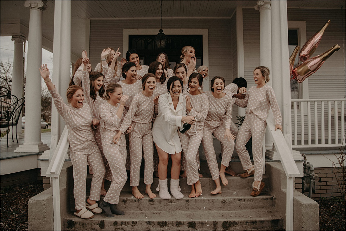 The bridal party wears brown and white polka dot pajamas to get ready in