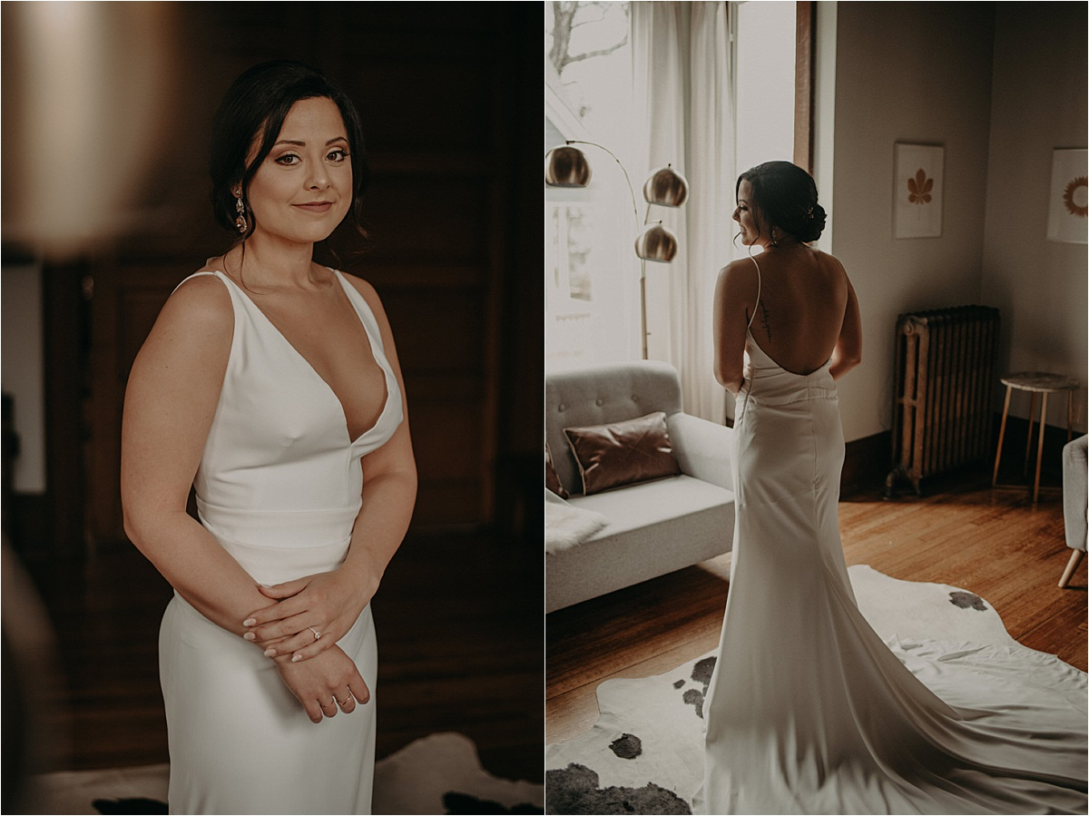The bride shows off the plunging neck and backline of her satin Lela Rose wedding gown