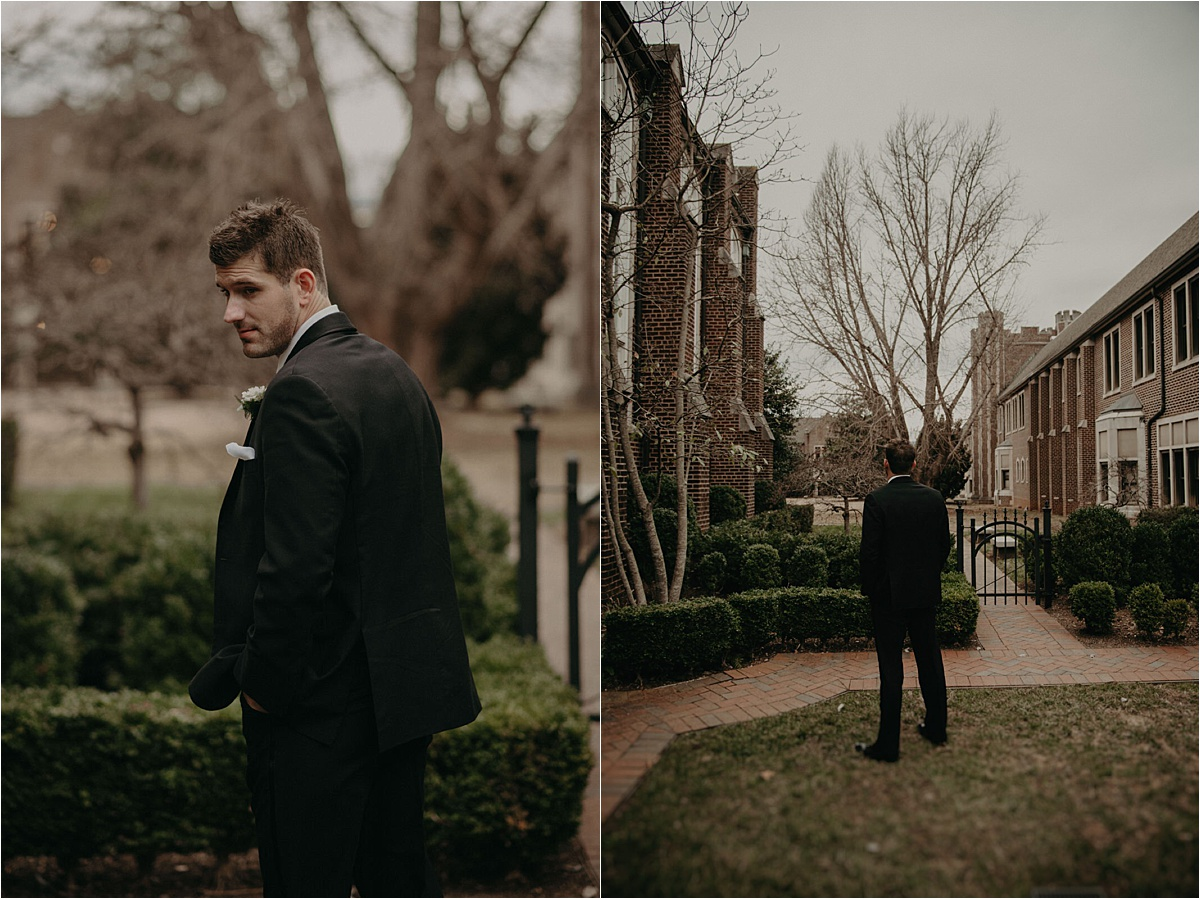 The groom waits for the first look with his bride in the gardens of Patten Chapel