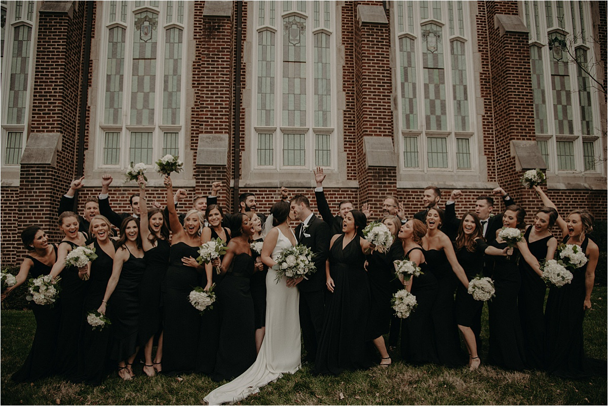 The wedding party celebrates the love of the bride and groom outside of Patten Chapel