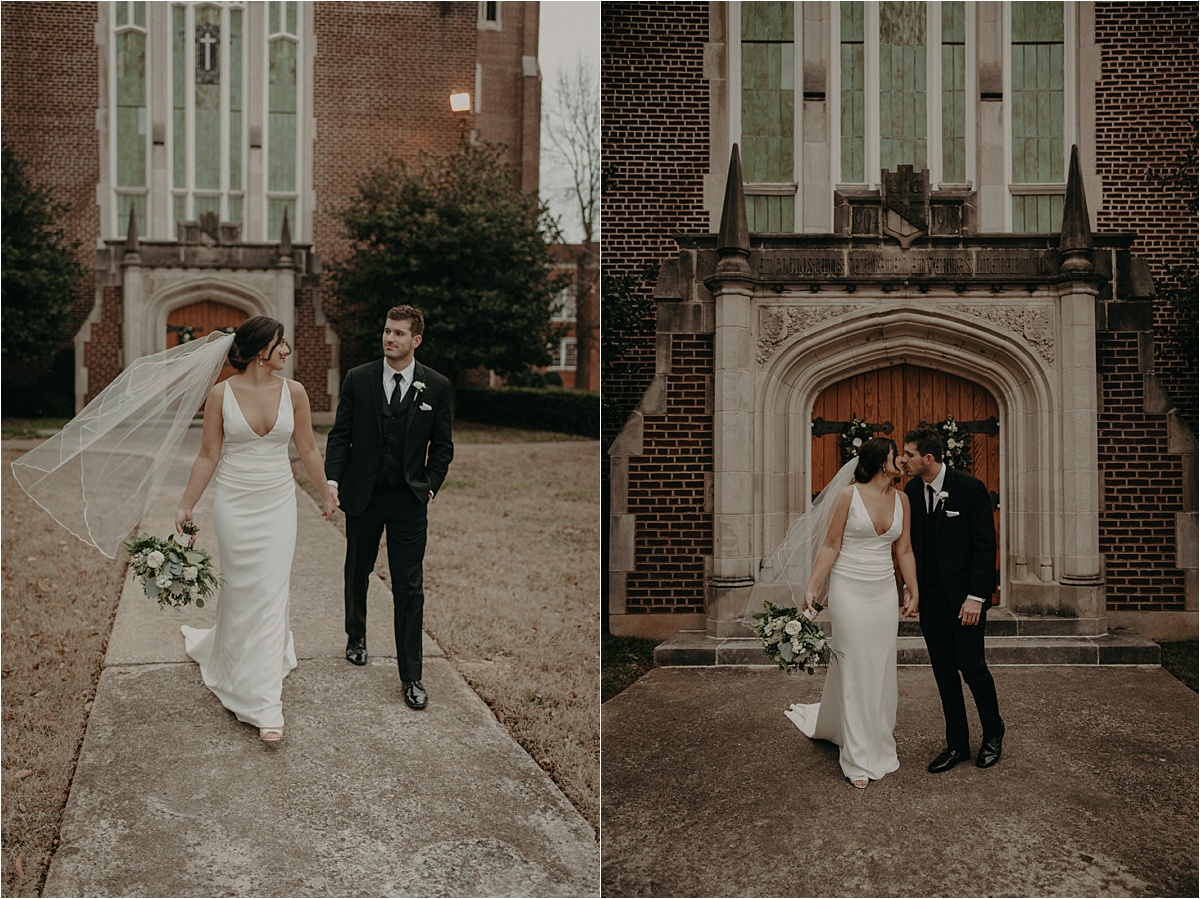 The bride and groom walk hand in hand in front of the beautiful wooden doors of Patten Chapel in Chattanooga, TN