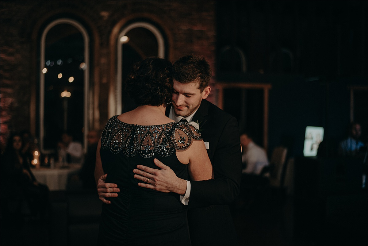 The groom dances with his mother