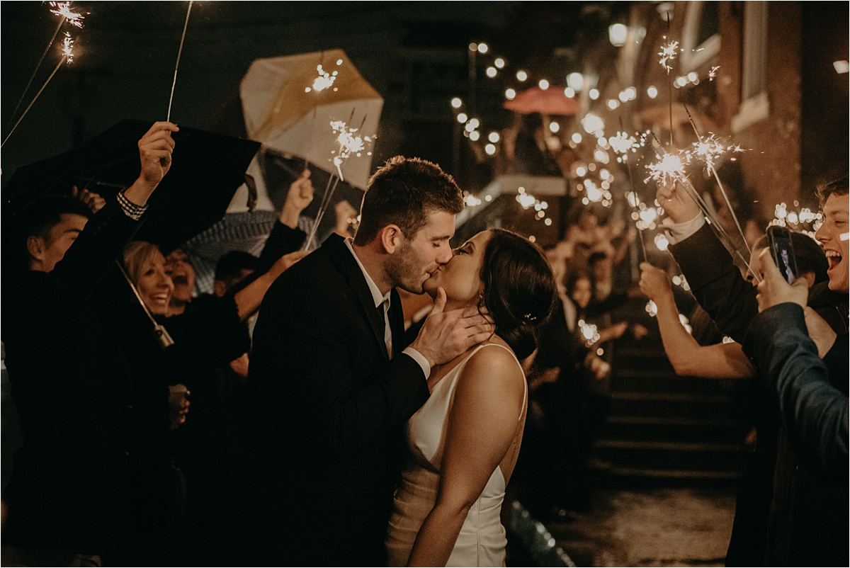 A beautiful sparkler exit for the bride and groom outside of the Church on Main