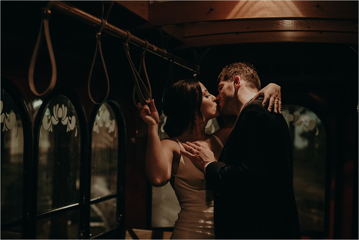 Sharing a kiss in Chattanooga, TN's trolley on a rainy wedding night