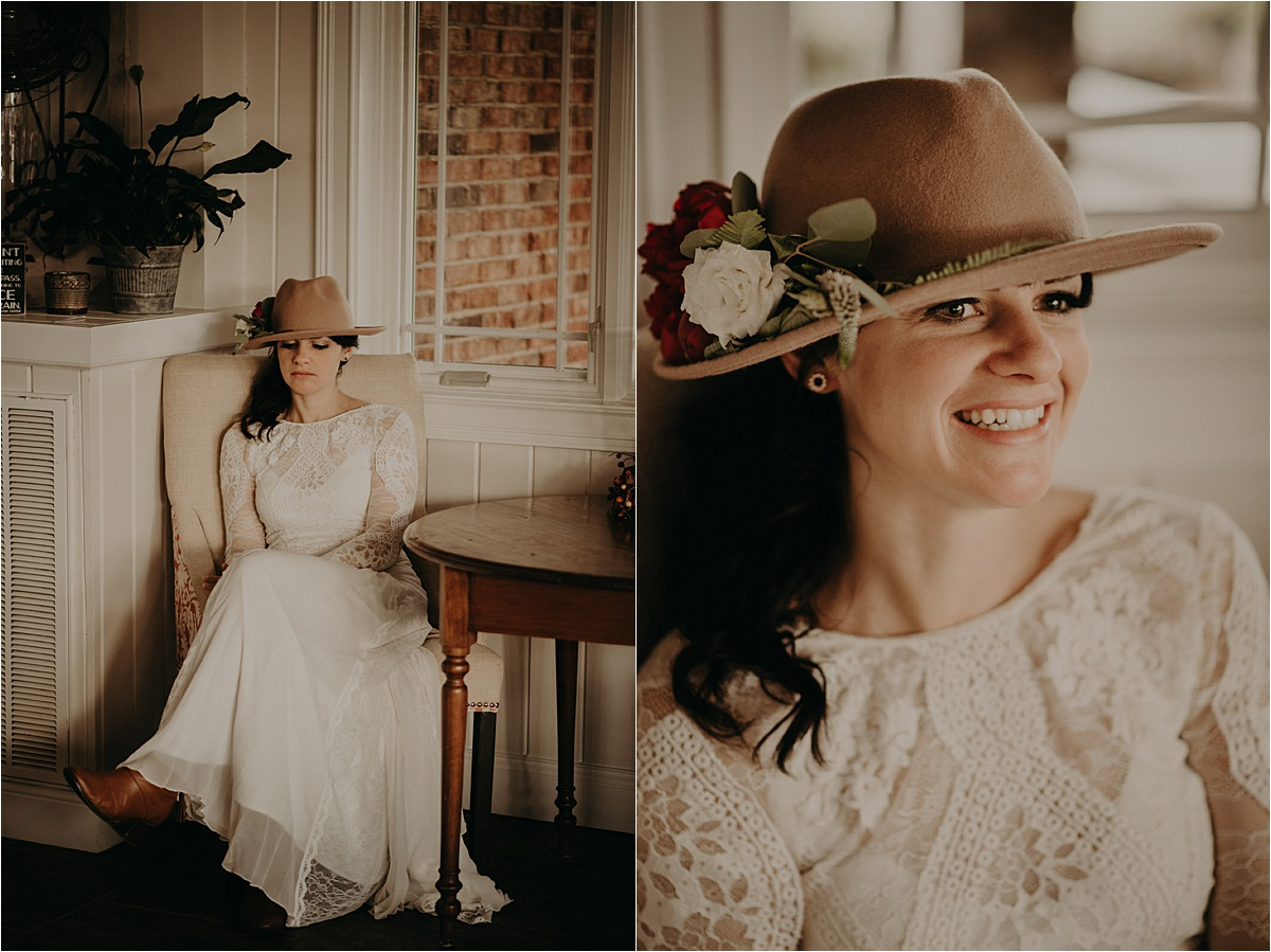 A boho bride in a Grace Loves Lace gown and camel hat with florals