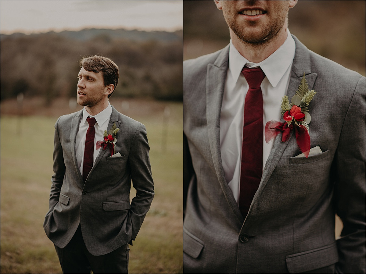 The groom wore a charcoal suit with a burgundy tie and tie clip
