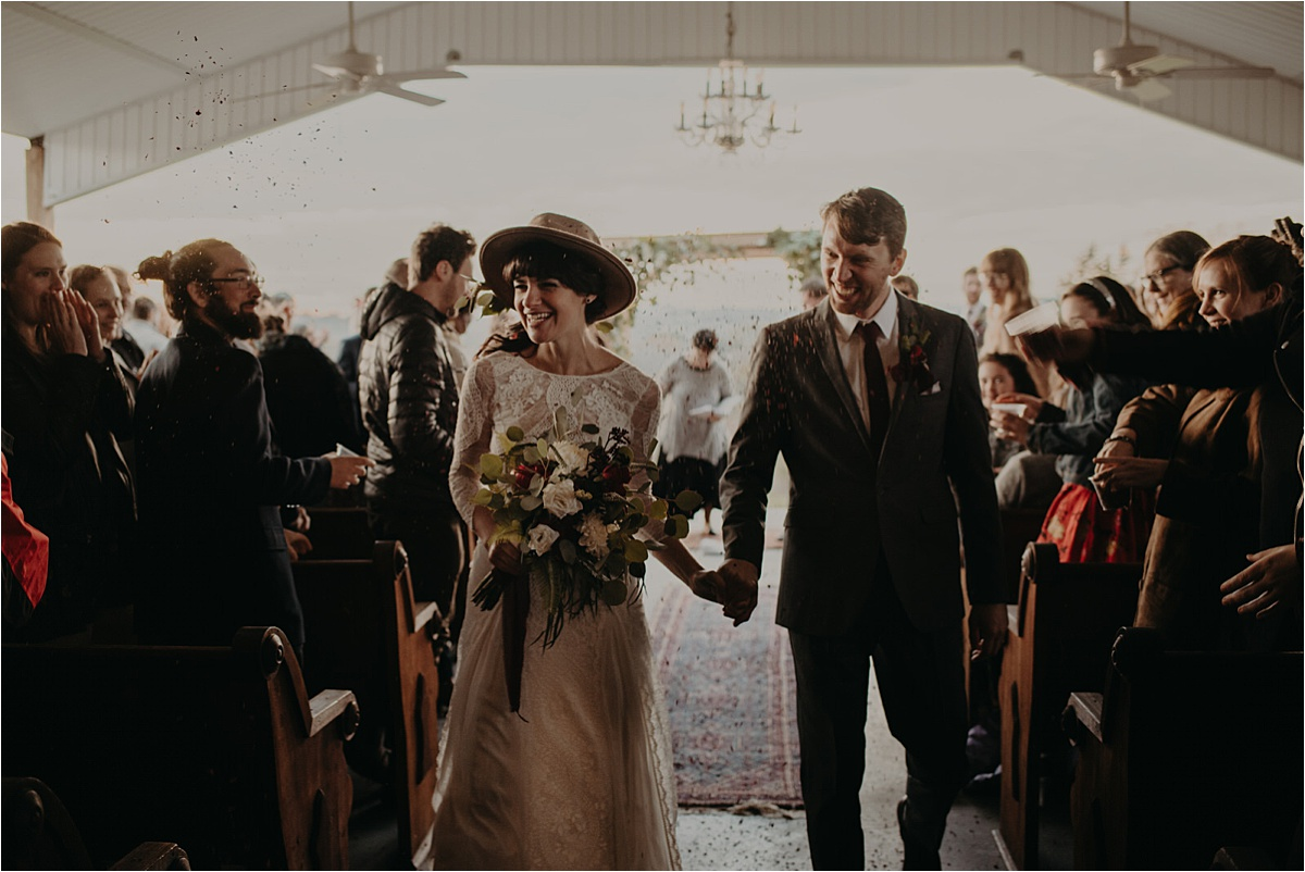 The guests threw flower confetti as the bride and groom came back down the aisle.