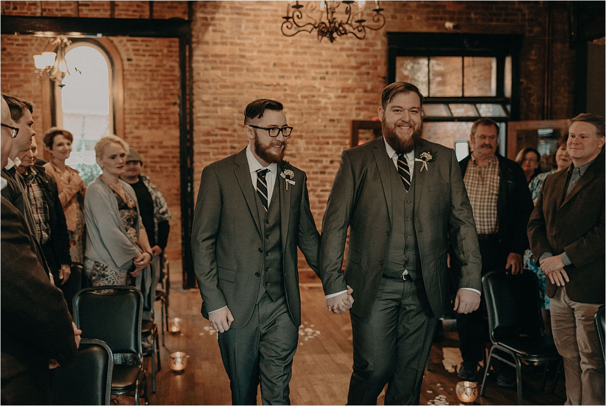 The grooms walk down the aisle together at this Chattanooga, Tennessee same sex wedding