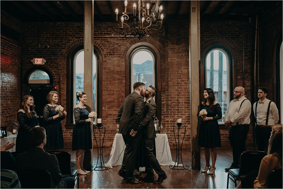 The grooms share their first kiss as husband and husband at this Church on Main wedding in Chattanooga, Tennessee