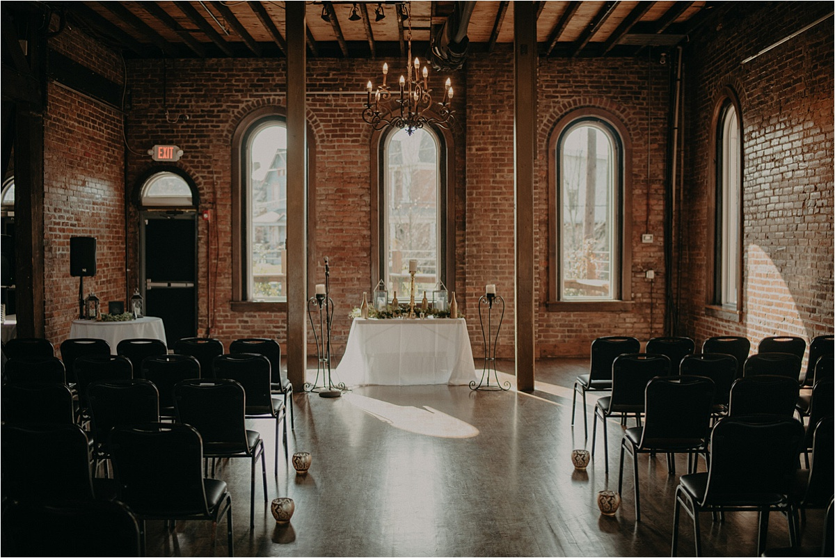 The Church on Main offers a multitude of ceremony setups. This couple chose the arched windows of the wedding venue for the backdrop of their ceremony.