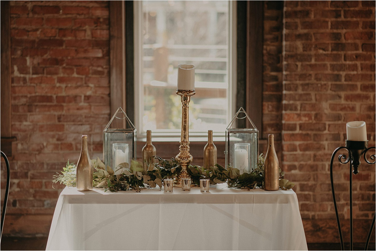Ornate gold decor and greenery at this Church on Main same sex wedding