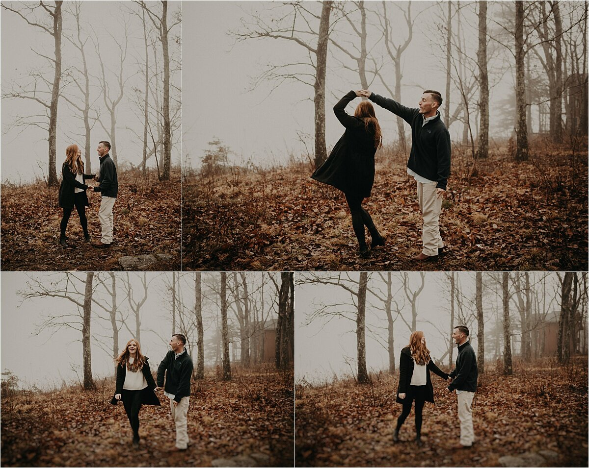 A stylish couple poses in the fog for their mountaintop engagement session