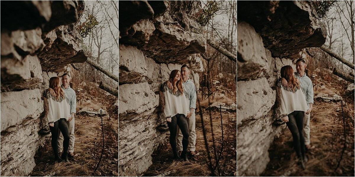 This couple is taking shelter beneath the rocks on this Tennessee mountain during their engagement session
