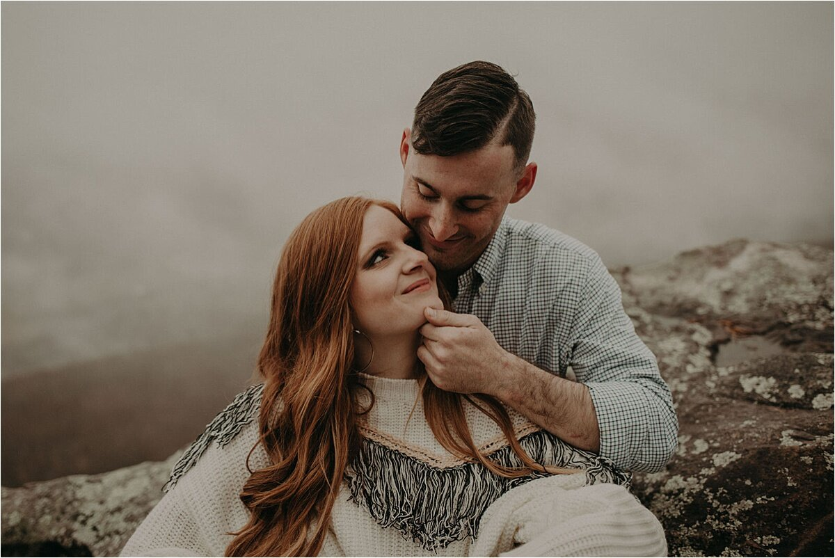 A sweet embrace by this newly engaged couple during their foggy love story photo session