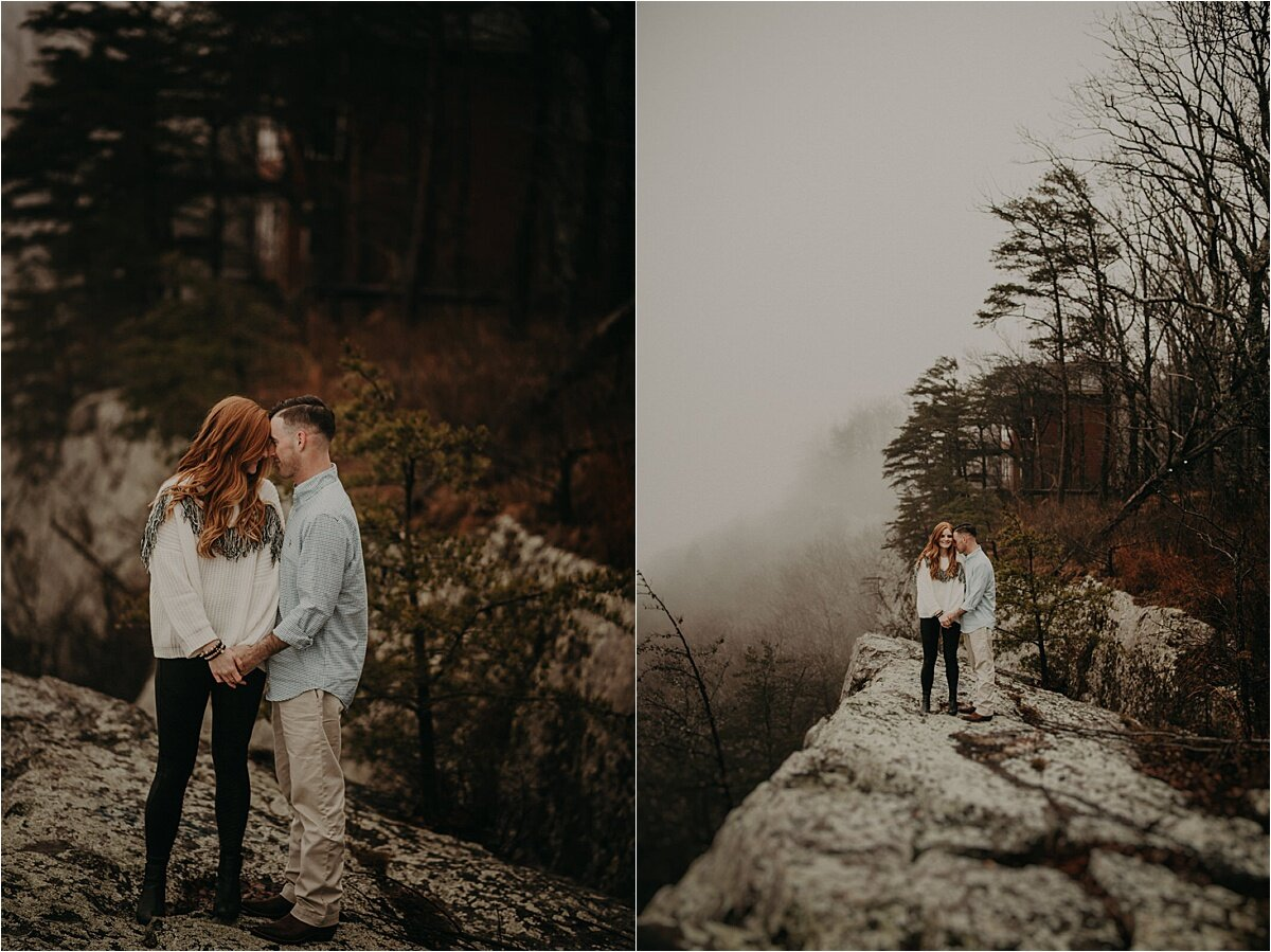 This couple stands cliffside on Lookout Mountain during white out conditions